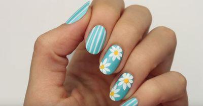 Gänseblümchen auf den Nägeln